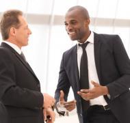 Two men talking in an elevtor