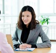Young business professional woman being interviewed