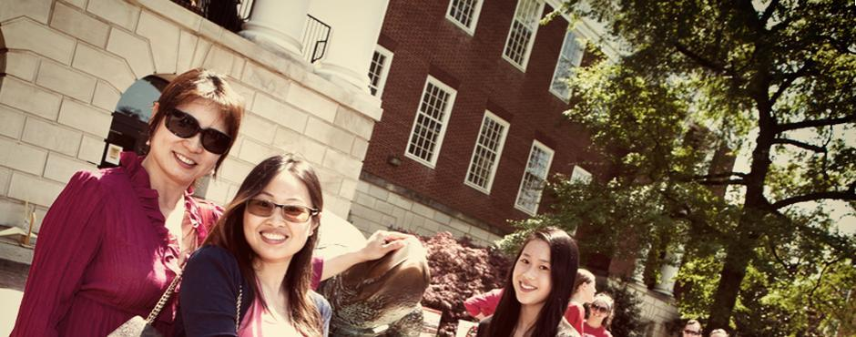 Students on steps with Testudo