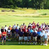 Student Affairs Golf Tournament participants pose on the greens of the University Golf Course.
