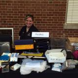 A DSA staff member with reusable office supplies at the office supply swap event