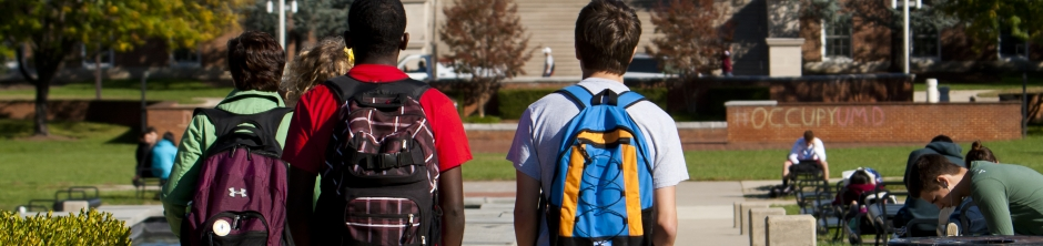 Students with backpacks walking on McKeldin Mall
